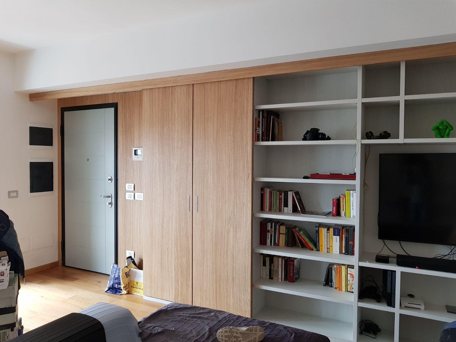Cucine Moderne Con Ante Scorrevoli.Libreria In Legno Ad Ante Scorrevoli Artenova Cucine In Legno
